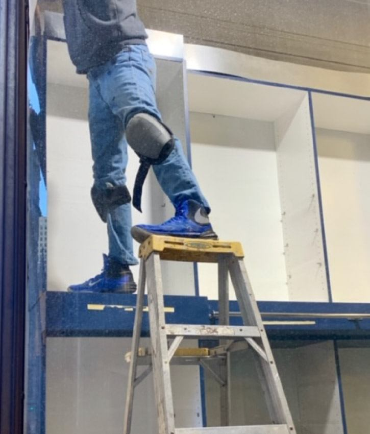 Construction worker using ladder in an unsafe way