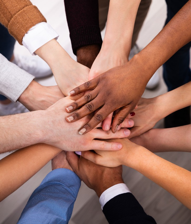 We're all in this together: Diverse people stacking hands together