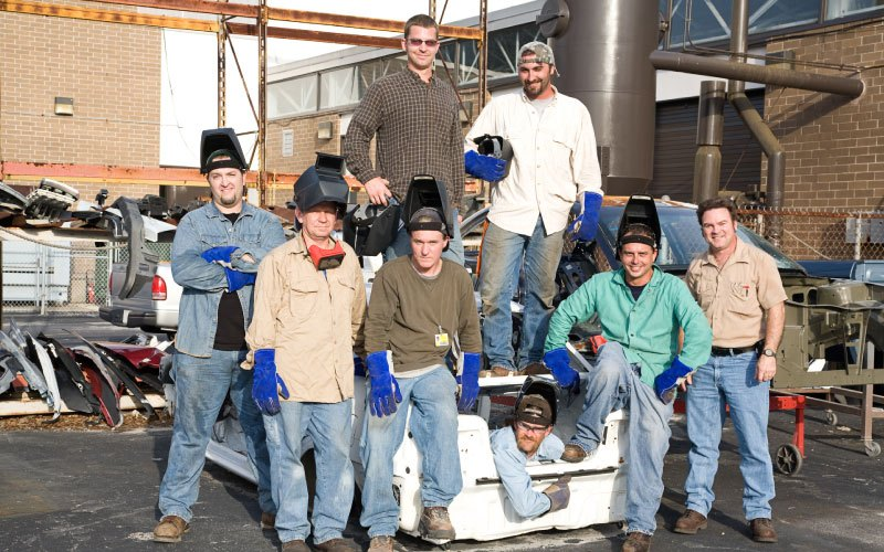 A group of metal workers and their supervisor