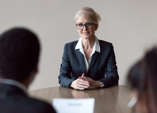 Smiling middle-aged female job applicant making first impression