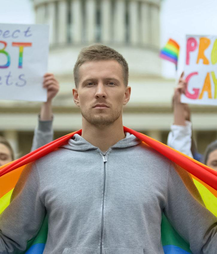 Male holding rainbow flag, fighting for respecting and protecting LGBT rights