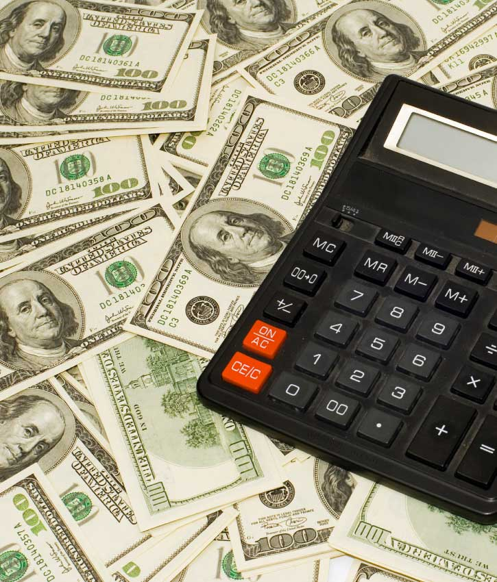 American 100 Dollar bills and calculator