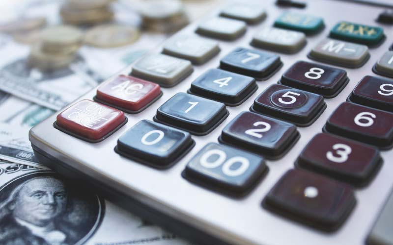 Unpaid Minimum Wage at Pelton Graham LLCclose-up of calculator and coins