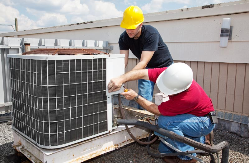 Industrial air conditioning repair technicians