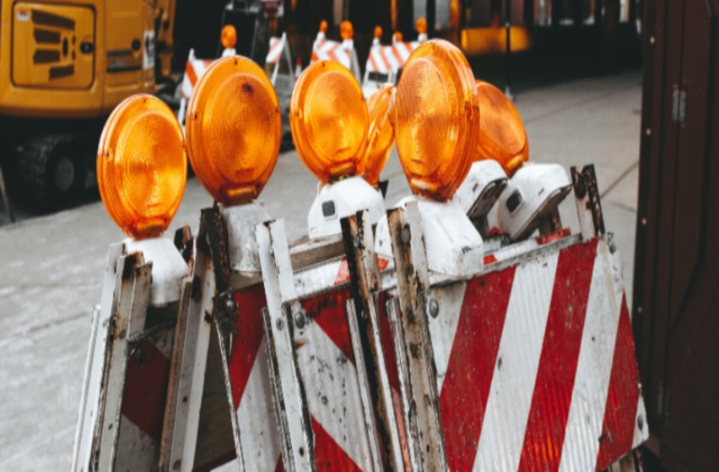 cluster of construction barricades with orange lights
