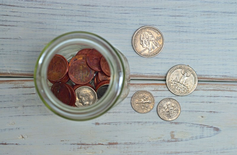 coins on table and in jar