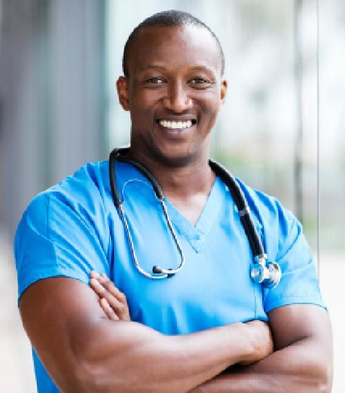 happy male African-American medical surgeon looking at the camera